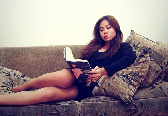 reading a book on the couch